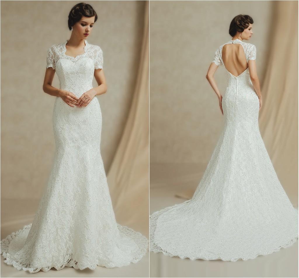 robe de mariée sirène dos nu en dentelle à manches courtes